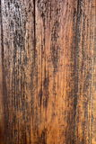 Background Image Shows Wood Grain of Old Barn Wood. Image shows wood grain, paint residue, and cracking on old barn wood Royalty Free Stock Photo