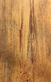 Background Image Shows Wood Grain of Old Barn Wood. Image shows wood grain, paint residue, and cracking on old barn wood Stock Image