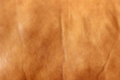 Background Image of Tan Leather. Tan leather with natural imperfections can be used as a background Stock Photo