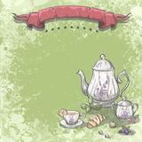 Background image with tea service with tea leaves, croissants and fruit Stock Photos