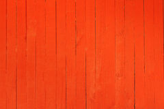 Background image of a wooden wall painted in bright red color.  Stock Photos