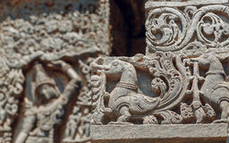 Background in Indian raditional style, with reliefs and fantasy birds inside the temple in India. Stock Images
