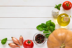 Background of ingredients for pumpkin soup. Vegetables on a wooden table. Top view. Stock Photography
