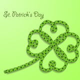 Background with inscription St. Patricks Day. Clover with four petals of green folded rope. Stock Images