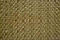 Background of intertwined natural rattan fibers. The texture of the rattan. Finishing material for interior decoration royalty free stock photos