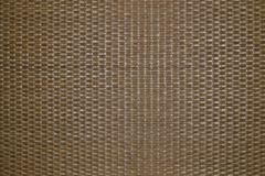 Background of intertwined natural rattan fibers. The texture of the rattan. Finishing material for interior decoration stock images