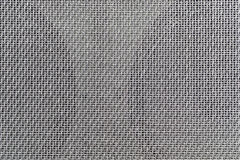 Background of interwoven wires. Abstract techno background with interwoven shiny metal wire gray Royalty Free Stock Images