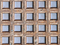 The background. Iron sewer cover many square bumps Royalty Free Stock Images