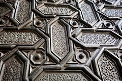 Background with Islamic patterns and Arabic calligraphy on door the 16th centure Seville Cathedral, Spain. Motifs in artworks of Andalusia royalty free stock images