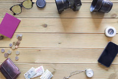 Background of items of trip on wooden table. Royalty Free Stock Image