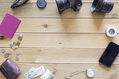 Background of items of trip on wooden table. Royalty Free Stock Photos