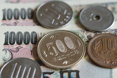 Background Japanese Yen Currency. Notes & coins Stock Photos