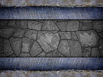 Background from a jeans fabric on stone wall Royalty Free Stock Photography