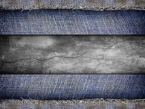 Background from a jeans fabric on stone wall Stock Images