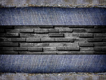 Background from a jeans fabric on stone wall Stock Photo