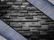 Background from a jeans fabric on stone wall Royalty Free Stock Photo
