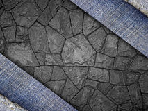Background from a jeans fabric on stone wall Stock Photography