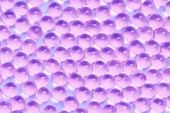 Background of jelly capsules. Jelly round capsules of purple color. royalty free stock photography