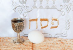 Background with Jewish unleavened bread and traditional food for Passover. Hebrew text translation is Happy holiday of Jewish Passover - pesah Stock Photos