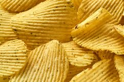 Background of juicy corrugated potato chips close-up stock photos