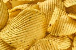 Background of juicy corrugated potato chips close-up royalty free stock image