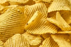 Background of juicy corrugated potato chips close-up royalty free stock photos