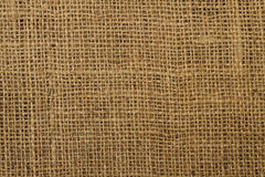 Background jute material. Background texture of an ancient brown jute material royalty free stock image