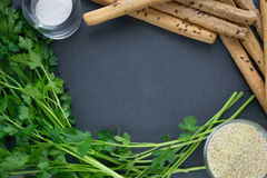 Background for kithen. Parsley and bread sticks on black background for design Stock Photo
