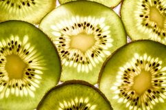 Background of kiwi slices. Lots of Vitamin C. stock photos