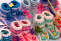 Background of the knitted baby shoes Royalty Free Stock Image