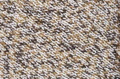 Background with a knitted fabric Stock Images