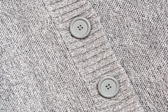 Background with Knitted grey with buttons Royalty Free Stock Images
