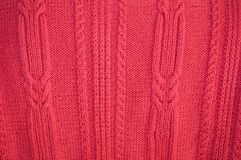 Background of knitted red pullover royalty free stock image
