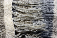 Background of knitted scarf in natural grey , beige, colors Royalty Free Stock Image