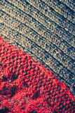 Background of knitting patterns. Background of knitting red and blue patterns, knitting wool texture background close-up, macro Royalty Free Stock Photography