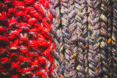 Background of knitting patterns. Background of knitting red and blue patterns, knitting wool texture background close-up, macro Royalty Free Stock Images