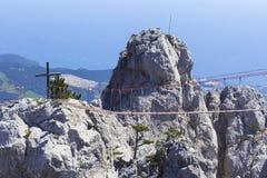 Background landscape hanging rope bridges between the peaks of Mount Ai-Petri. At high altitude, Yalta, Crimea stock image