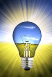 Background with landscape inside light bulb Royalty Free Stock Photos