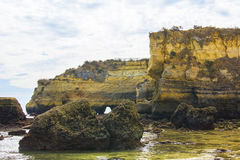 Background landscape view of the cliffs and islands near the beach in Lagos Royalty Free Stock Images