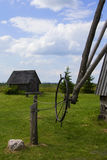 Background landscape view of an old mill, a barn and a field in the museum complex of ancient everyday life Dudutki Stock Photos