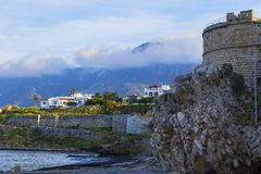 Background landscape view of the quay of Kyrenia and the tower of the Kirinis fortress on the north stock image
