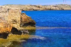Background landscape view of the rocky coast in the reserve at Cape Capo Greco, Protaras royalty free stock images