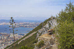Background landscape view of the top of the Rock of Gibraltar, an abandoned military battery, a weather station and city Royalty Free Stock Image