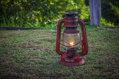 Background with lantern in grass. Warm candle light. Royalty Free Stock Image