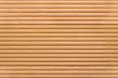 Background of lath. Fragment of a wall of wooden slats for use as a background royalty free stock photo
