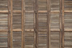 Background latticed wooden doors texture in the tropical house Royalty Free Stock Images