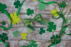 Background leaf clover, ribbons, green and gold beads shiny bow Royalty Free Stock Photos