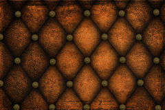 Background leather with decor. Background brown leather upholstery with metal decor Royalty Free Stock Photography