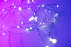 Background with led garland in trendy neon colors.