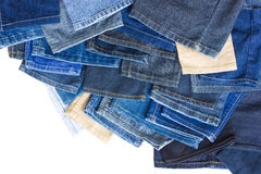 Background leg jeans overlap. Isolates background of colorful jeans legs left over from sewing, which overlap each other Stock Photos